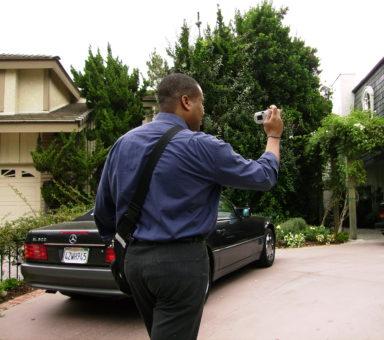 Darius photographing exterior of home