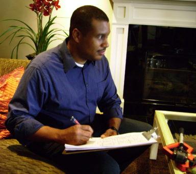 Darius writing on clipboard